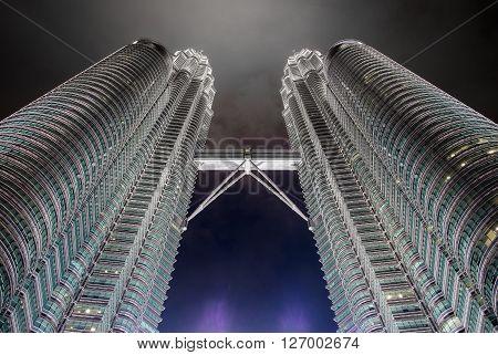KUALA LUMPURMALAYSIA - FEBRUARY 29: Petronas twin towers on February 29 2016 in Kuala Lumpur Malaysia. Night time of twin towers.