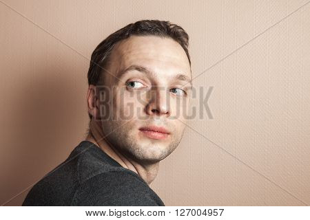 Young Caucasian Proud Man Portrait Over Gray Wall