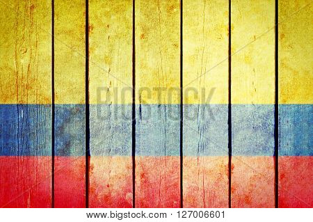 Colombian wooden grunge flag. Colombian flag painted on the old wooden planks. Vintage retro picture from my collection of flags.