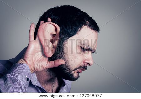 bearded man closeup with the big ear