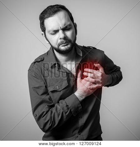 bearded man closeup having the heart pain