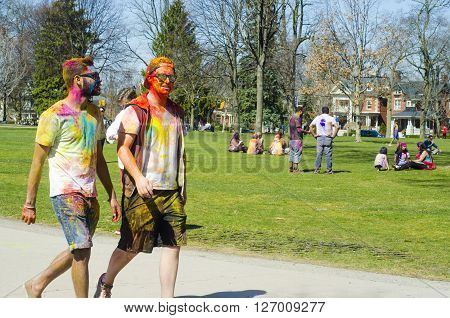 London Ontario, Canada - April 16: Two Unidentified Young Colorful Boys Walking In The Park And Cele