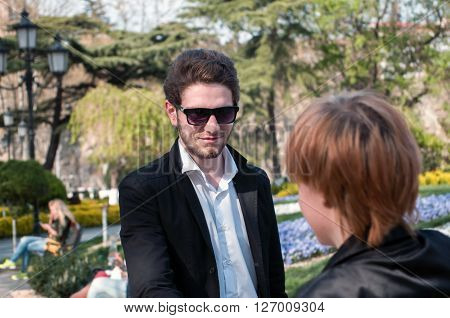 young business man and woman shaking hands