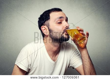 funny bearded man close up drinking beer