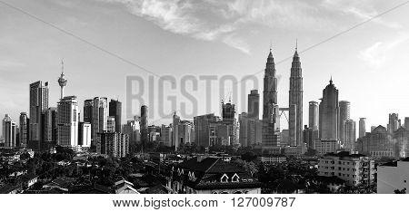 KUALA LUMPUR MALAYSIA - 13TH MARCH 2016; Black and white of downtown Kuala Lumpur a modern skyline 451m-tall KLCC skyscraper.