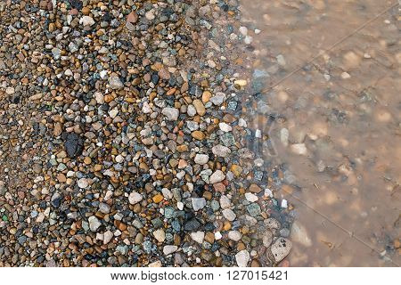 Puddle and mud with pebble. background or texture