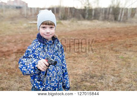 Young Boy With  Gun.