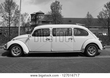 Almere, The Netherlands - April 24, 2016: White Volkswagen stretched Beetle Limousine parked on a public parking lot in the city of Almere.