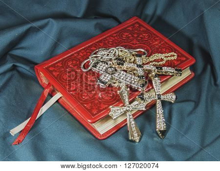 religion, Orthodoxy, the bible in leather cover and crosses jeweler