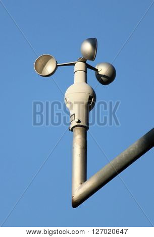An anemometer instrument on blue sky background