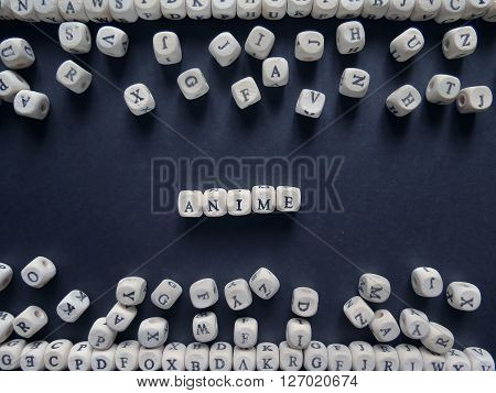 Word Anime Of Small White Cubes Next To A Bunch Of Other Letters On The Surface Of The Composition O
