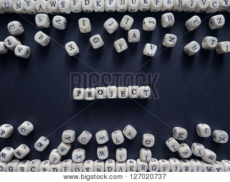 Word Project Of Small White Cubes Next To A Bunch Of Other Letters On The Surface Of The Composition