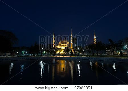 fountain on Sultanahmet square in front of the Blue mosque (Sultan Ahmed Mosque)in Istanbul in the evening