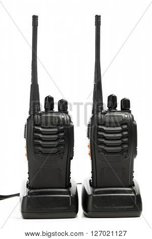 portable radios Walkie-talkie on charging stations, isolated on white