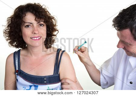 Doctor Giving An Injection To Female Patient Isolated