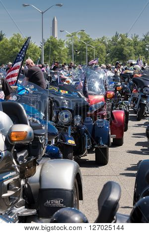 Arlington VA USA May 25 2015: Rolling Thunder Motorcycles assembling in the Pentagon parking lot. Washington Monument visible in the background.