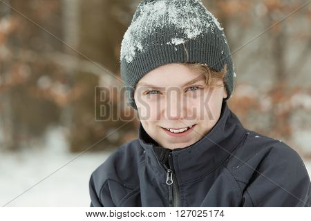 Smiling Happy Young Boy Covered In Snow