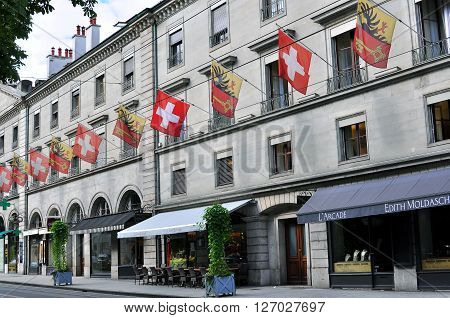 GENEVA SWITZERLAND - AUGUST 17: Facade of the house in Geneva downtown on August 17 2015. Geneva is the second largest city of Switzerland.