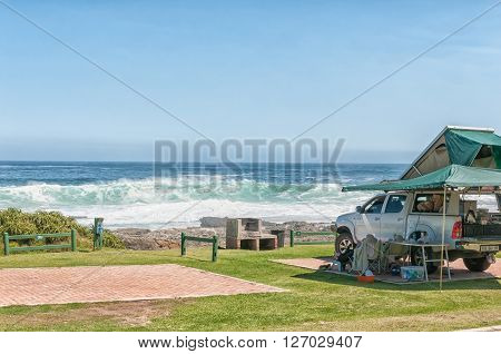 STORMS RIVER MOUTH SOUTH AFRICA - FEBRUARY 29 2016: A pick-up truck with roof ten and a sea view in a typical view at the rest camp at Storms River Mouth