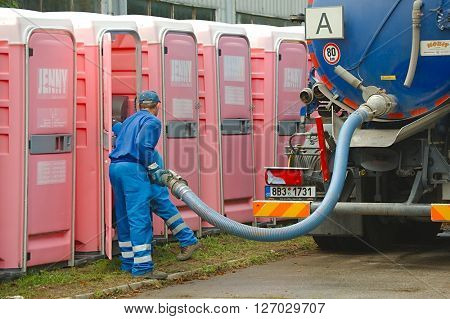 HODONIN, CZECH REPUBLIC - AUGUST 17: Cleaning of the mobile toilets at Made of Metal, August 17th 2014.