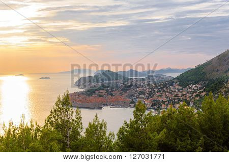 Bird's-eye view of Dubrovnik old city from the east at sunset and Dalmatian islands in the distance