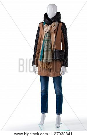 Brown jacket and black bag. Mannequin wearing jacket with purse. Lady's outerwear with classic handbag. Clothes selection in outlet store.