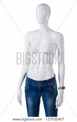 Blue jeans and small watch. Mannequin wearing jeans with watch. Lady's new pants and accesscory. Last merchandise in stock.