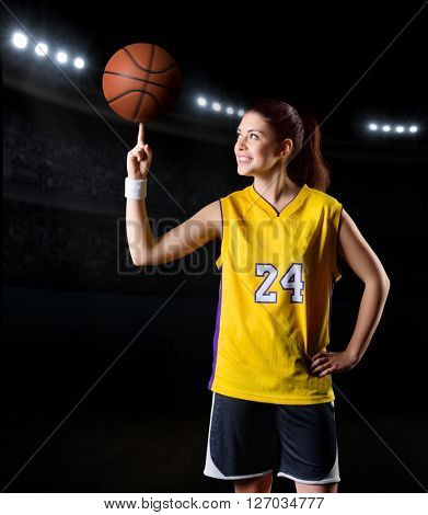 Young girl basketball player in sports hall