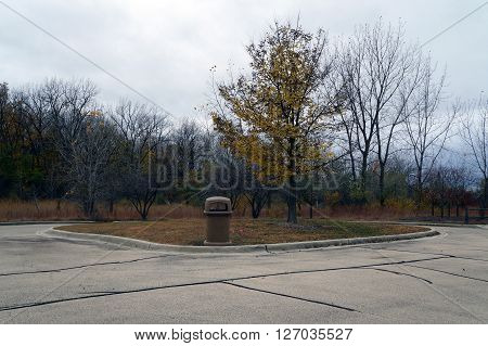PLAINFIELD, ILLINOIS / UNITED STATES - OCTOBER 24, 2015: Visitors to the Lake Renwick Heron Rookery Nature Preserve may deposit their trash in the available receptacle in the parking lot.