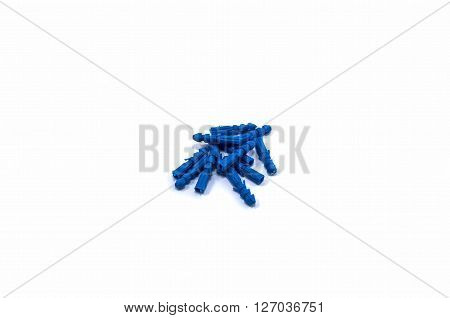 several blue plastic dowels for mounting on the wall