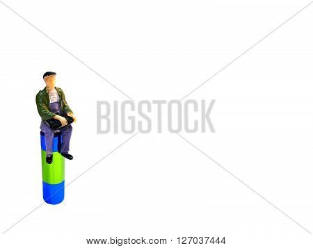 Miniature Man Sitting On Aa Battery Isolated On White With Room For Copy Space