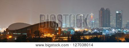 Calgary cityscape in Alberta at night in a foggy day, Canada.