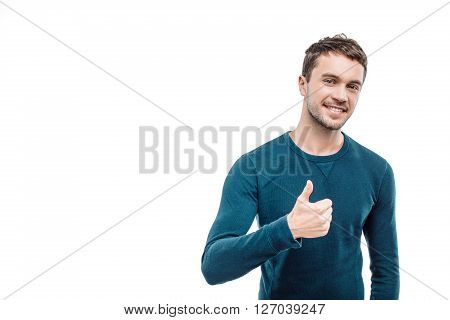 Portrait of stylish handsome young man isolated on white background. Man smiling, showing thumb up and looking at camera. Free space for logo