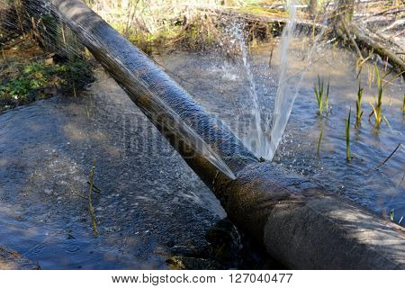 Water jet escaping from a broken pipe