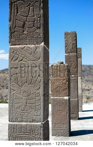 Ancient Toltec columns with writing on it