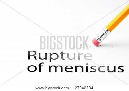 Closeup of pencil eraser and black rupture of meniscus text. Rupture of meniscus. Pencil with eraser.