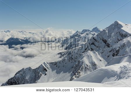 Winter mountain landscape and cloudy sky.