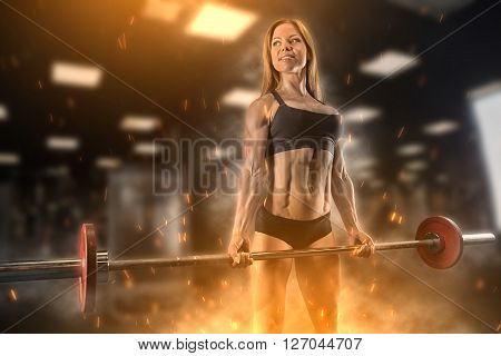 Fitness Girl Posing In The Gym