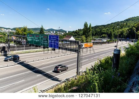 NEUENHOF, SWITZERLAND - JULY 21, 2015: Views of the motorway A1 near the Baregg Tunnel and the cities of Baden Neuenhof and Wettingen on July 21, 2015. The motorway A1 ist the oldest in Switzerland.