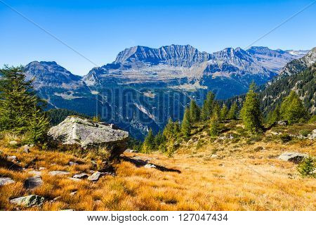 View of the mountains and valley on the hiking trail near Buffalora hut in ticino Switzerland