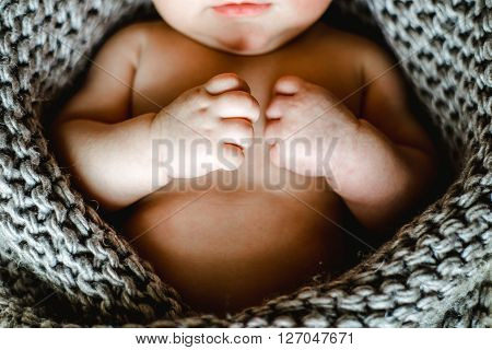 little hand of sleeping baby newborn close up. little hand of sleeping baby newborn close up