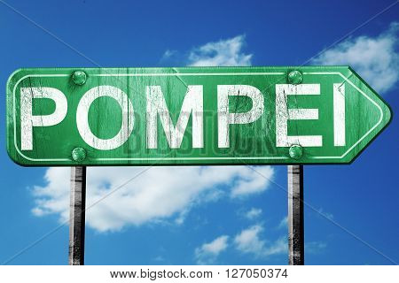 Pompei road sign, on a blue sky background