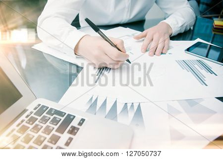 Investment manager working process.Photo trader work market reports documents.