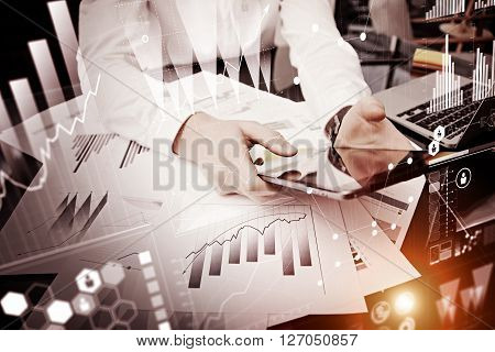 Photo man hand touching modern tablet.Using electronic device. Graphic icons, worldwide stock exchanges interface on screen.