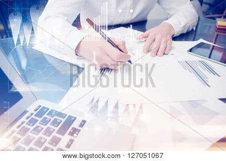 Concept photo trader work market report documents.Using electronics devices. Graphic icons, stocks exchanges reports screen interfaces.