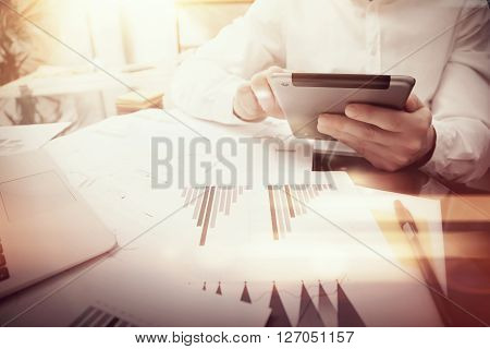 Photo trader work market report modern tablet.Using electronic device.Graphic icons, exchange reports documents.
