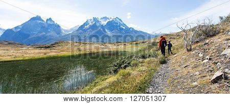panorama of family hiking in beautiful torres del paine national park patagonia chile active travel concept