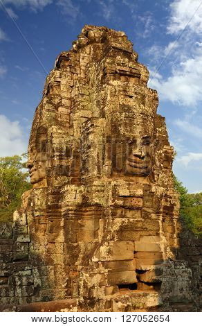 Giant stone faces at Bayon Temple at sunrise, Angkor Wat, Cambodia