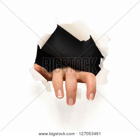 Hands ripping a hole in white paper with torn edges, isolated