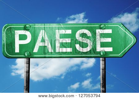 Paese road sign, on a blue sky background